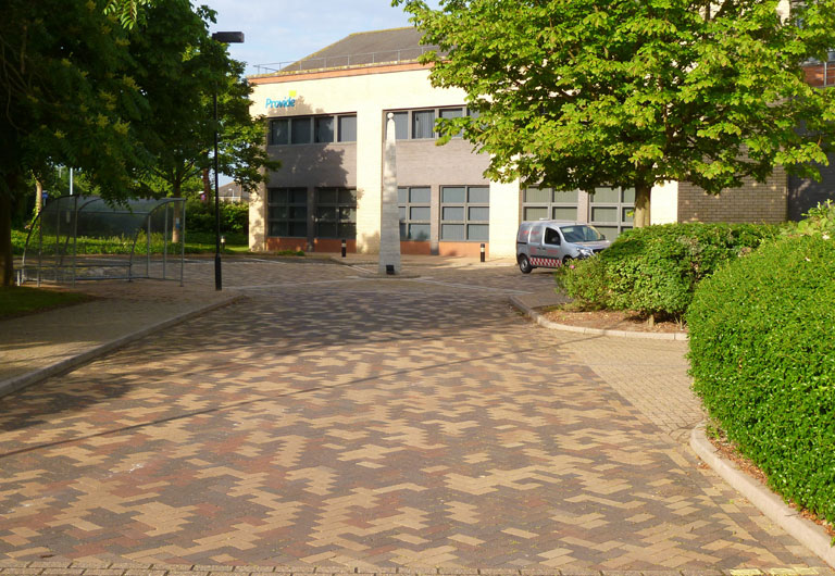 Pressure washed and cleaned business property parking area